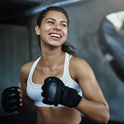 woman with boxing gloves on